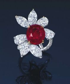 oval-shaped ruby and diamond ring