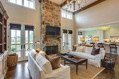 A living room with style! Tall ceilings and windows make this a great space for lounging, reading a good book, or entertaining your guests! #GroveLiving #TN #Livingrooms