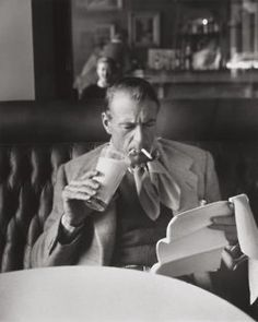 Gary Cooper. Drinking milk. Smoking. Reading script.