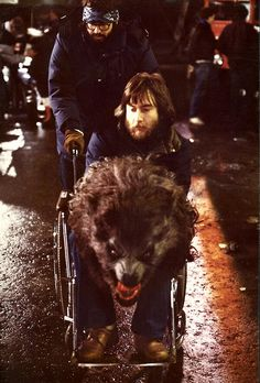 American Werewolf in London: Rick Baker operates the wolf for the Piccadilly Circus scene while being pushed by John Landis.