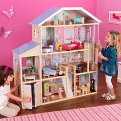 Make your little girl's dream come true with the Majestic 4 Story Mansion.  The mansion features eight rooms, including master bed and bath, kitchen, dining room, attic, and garage. This durable dollhouse is crafted from wood and includes 33 furniture pieces and accessories. It accommodates fashion dolls up to 12 inches tall.
