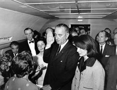 November 22, 1963, President Lyndon B. Johnson takes the oath of office aboard Air Force One.