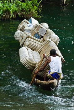 Moving his house by boat. Photo by Yannick Garcin, taken on the Barombi Mbo crater lake in Cameroon, Africa. We Are The World, People Around The World, Wonders Of The World, Around The Worlds, Cultures Du Monde, Africa Travel, Les Oeuvres, Transportation, Funny Pictures