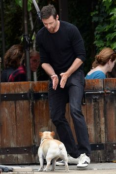 Stay: Hugh tried to coax his faithful, four-legged companion to stay put so he could grab a bite with wife Deborra-Lee Furness and their dau...
