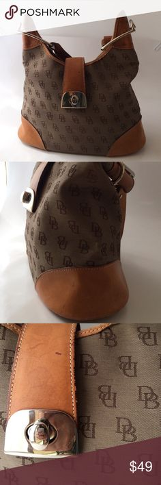"Dooney and Bourke Hobo Bag This neutral hobo bag is your go-to essential for any occasion. Gently used, this leather matches with any piece. Some minor water stains. The logo printed fabric is also in pristine condition. Height-11. 1/2"", width- 4 1/2, drop--13"". Offers warmly received. Dooney & Bourke Bags Hobos"
