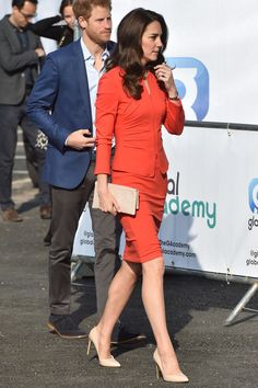 The Duchess of Cambridge wear a red Armani suit to visit the Global Academy with Prince Harry