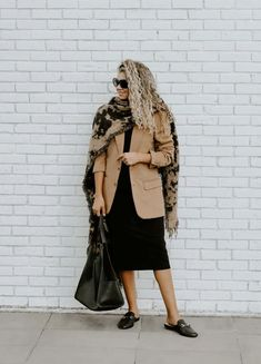 One big way to maximize your wardrobe is to make your summer clothes work for fall/winter and vice versa. You can get more mileage out of your wardrobe by making your summer clothes work for the colder seasons. And not only that, but you'll save money by buying less clothes as well. Here's how! #classicfalloutfit #camelblazer #blanketscarf