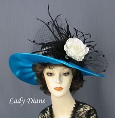 Kentucky Derby  Blue with Black Feathers and White Flower