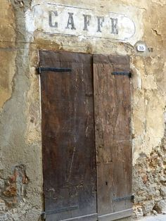 Caffe entrance. Love this old door
