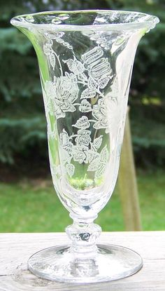 We are pleased to offer this elegant Heisey Rose Etch Vase.This is a difficult piece to find, in an ever popular pattern!  The detail in the beautiful   offered by rubylane shop Cousins Antiques
