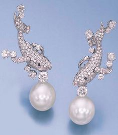 A PAIR OF DIAMOND AND SOUTH SEA CULTURED PEARL EAR PENDANTS, BY MIKIMOTO