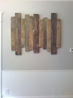 Step by Step instructions on how to make staggered pallet art.