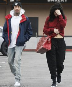 Kylie Jenner covers her face as she steps out with boyfriend Tyga | Daily Mail Online