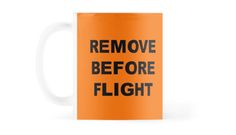 """Orange mug with a """"Remove Before Flight"""" warning in black letters Copyright: Escarpatte Orange Mugs, Black Letter, Cool Designs, Iphone Cases, How To Remove, Letters, Glasses, Tableware, Shirt"""
