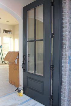 Door painted in Benjamin Moore Wrought Iron. One of the best dark door and trim … Door painted in Benjamin Moore Wrought Iron. One of the best dark door and trim colors. by alisha - Door Style At Home, Benjamin Moore Wrought Iron, Benjamin Moore Exterior, White Dove Benjamin Moore Walls, Dark Doors, Br House, House Trim, Exterior Paint Colors, Paint Colours