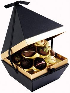 Finest* contemporary chocolate collection Tesco: This pyramid-shaped box of del. Finest* contemporary chocolate collection Tesco: This pyramid-shaped box of del. Cake Boxes Packaging, Chocolate Box Packaging, Bakery Packaging, Food Packaging Design, Chocolate Shop, Chocolate Gifts, Chocolate Boxes, Truffle Boxes, Japanese Packaging