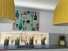 """Our kitchen prior to painting the fence behind. Love the freedom print """"oarsome"""". Stag horn ferns to go on the outside wall shortly. Raw concrete Caesar stone benchtop."""