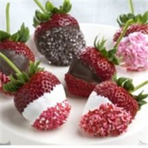 Chocolate-Covered Strawberries with Sprinkles - A springtime confection that everyone adores! Plump, red ripe stemmed strawberries dipped in chocolate and gilded with chocolate sprinkles.