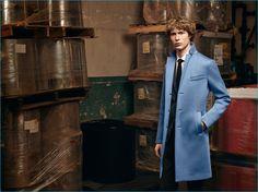 Sven de Vries dons a light blue car coat from BOSS' fall-winter 2016 collection.