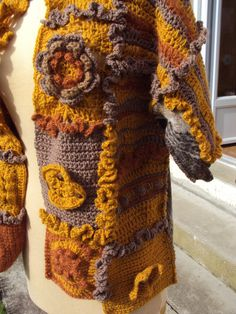 Original jacket made crochet free form for the lead with of the wool several shades in wool and acrylic, Scottish fabric 80% wool, 20% polyester on
