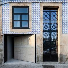 OODA completes modern apartment renovation  behind tiled facade in Porto http://www.dezeen.com/2014/05/24/ooda-completes-modern-apartment-renovation-behind-tiled-facade/