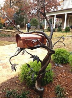 Welded Mailbox holder. I don't know who the creator is.