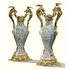 A pair of gilt-bronze-mounted vases, circa 1860, handles with dragons, branches of peaches, pomegranates and peonies on a turquoise ground,Sotheby's.