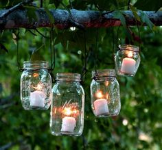 The easiest & super charming DIY hanging mason jar lights using up-cycled glass bottles and dry cleaners wire hangers. Detailed step by step tutorial! - A Piece of Rainbow