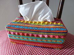tissue box cover. check out the beautiful colors, stitch patterns, and embellishments. gorgeous!