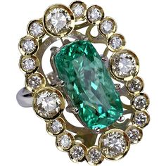 Exclusive One-of-a-Kind GIA 6.84ct Paraiba Tourmaline and Diamond Ring
