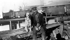 Florida Memory - Captain Will Newman sitting on the dock with dog and cat - Palatka, Florida