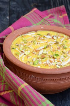 Mango Phirni is a Mango twist on a classic Indian dessert Phirni. It is made using rice and is flavored with mango puree. Here is how to make it.