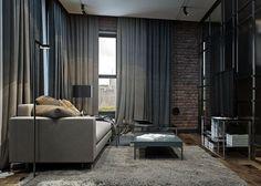 salon moderne avec mur en brique, rideaux, tapis shaggy et canapé gris