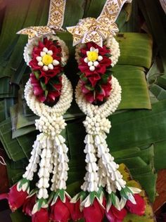 """In a traditional Thai ceremony, as in Hawaiian ceremonies, flower garlands are exchanged in addition to rings. Rings demonstrate that we want our love to be eternal, solid and concrete, and never-ending, like a circle. Giving flowers symbolizes the fragrance of marriage and the beauty of life. And because flowers are delicate, they are also apt reminders of the fragility of life."""" Plum Wedding Flowers, Church Wedding Flowers, Wedding Boxes, Wedding Ideas, Floral Garland, Flower Garlands, Flower Decorations, Hawaiian Wedding Rings, Giving Flowers"""