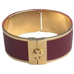 Pre-owned Tory Burch Leather Cuff ($128) ❤ liked on Polyvore featuring jewelry, bracelets, accessories, burgundy gold, leather bangle, cuff bangle bracelet, hinged cuff bracelet, hinged bangle and hinged bangle bracelet