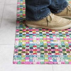Mat made out of woven ribbon tape measures.  Cute and fun idea, and easy to execute.  Where to find so many pretty colorful tape measures, though?