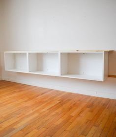 How to add tons of storage to your living room using stock cabinets and basic supplies. Create your own floating credenza! Floating Wall Unit, Floating Tv Cabinet, Wall Cabinets Living Room, Living Room Storage, Storage Spaces, Stock Cabinets, Diy Cabinets, Diy Home Decor, Room Decor