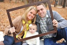 Family with empty picture frame