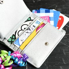 Giving gift cards is one of the greatest ways to make someones birthday, holiday or special occasion fun, but if you need some creative gift card holder ideas, this one is super fun! Fill a wallet with gift cards and your recipient will love it! #giftidea #birthdaygift
