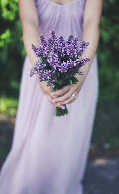 bridesmaid with lilac bouquet