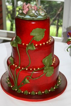 Red Cake topped with frogs and lily pad leaves.