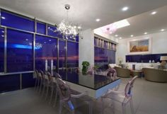 Architecture:Glossy Decoration Room With Cool Blue Glass With Sleek Dining Table And Arcylic Seats Design With Unique Pendant Lamps Building...