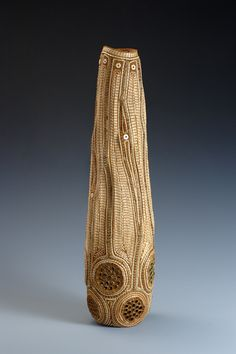 """New Growth"" by Jan Hopkins, 2006. Made of lotus pod tops, yellow cedar bark, ostrich shell beads and waxed linen"