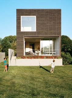 Aluminum-clad wood Unilux windows and Arcadia sliding doors on Rhode Island family vacation home by Bernheimer Architecture.