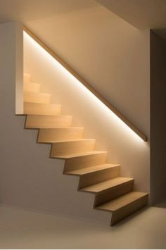 hidden lights in the banister lights up the staircase so the owners don't need any lights while walking up or down