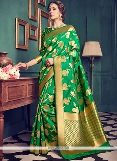 Enchant the mantra of being stylish in this attire. This green art silk designer traditional saree is accenting the gorgeous feeling. This attire is showing some really mesmerizing and innovative patt...