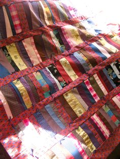Great quilt idea for Junebug's bed  Fabric samples & men's ties into a quilt.
