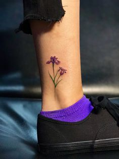 Iris tattoo by cute ankle tattoos, leaf tattoos, tatoos, tattoo designs Lila Tattoos, Violet Flower Tattoos, Grandma Tattoos, Violet Tattoo, Beautiful Flower Tattoos, Pretty Tattoos, Tatoos, Iris Tattoo, 21 Tattoo