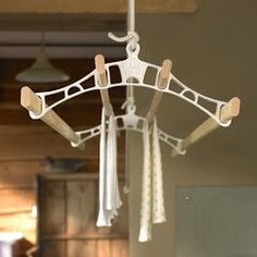 The pulley maid deluxe ceiling clothes airer drying rack hanging in a traditional country kitchen setting. The rack ends are white and the wooden laths pas through them as the washing is hung to dry in the laundry utility room. Drying Rack Laundry, Clothes Drying Racks, Clothes Dryer, Clothes Hanger, Laundry Hanger, Clothes Horse, Wooden Drying Rack, Hanging Drying Rack, Hanging Dryer