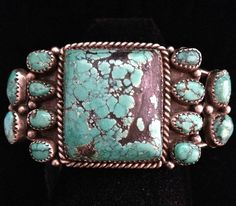 Great old 1950's pawn sterling bracelet w/1 lg square turquoise and 12 smaller turquoise stones.